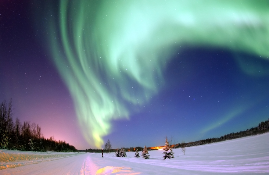 EIELSON AIR FORCE BASE, Alaska -- The Aurora Borealis, or Northern Lights, shines above Bear Lake here Jan. 18. The lights are the result of solar particles colliding with gases in Earth's atmosphere. Early Eskimos and Indians believed different legends about the Northern Lights, such as they were the souls of animals dancing in the sky or the souls of fallen enemies trying to rise again. (U.S. Air Force photo by Senior Airman Joshua Strang)
